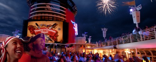 Guests on Disney cruise ship watching fireworks