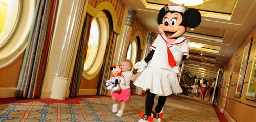 A young guest enjoys time with Minnie
